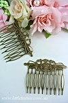 Metal filigre comb with 8 teeth. x 5