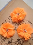 Neon orange fabric flowers. 2.5'. x3